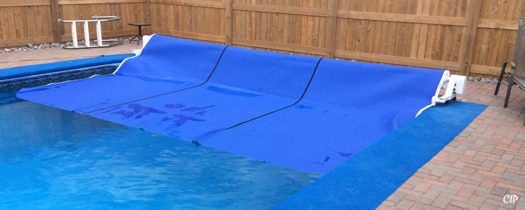 Automatic pool cover enclosures