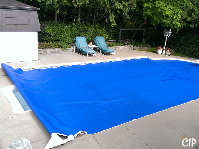 Pool covered with Automatic Pool Reel USA